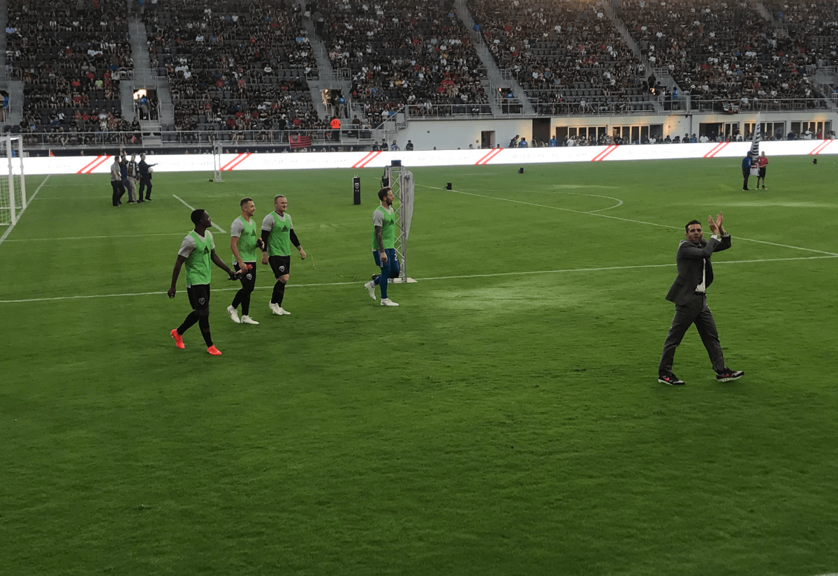 Wayne Rooney, third from left, enters Audi Field during his D.C. United debut on July 14, 2018