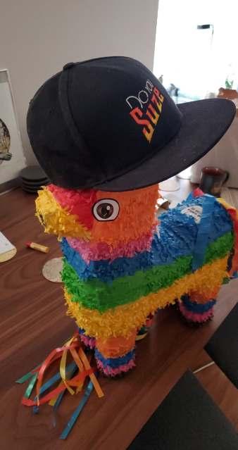 Piñata wearing a hat