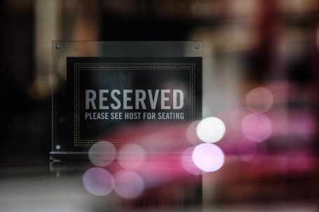 Reserved please see host for seating sign