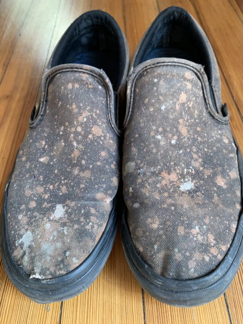 Black shoes with bleach stains