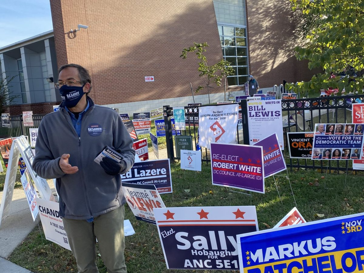 Ed Lazere campaigns outside Turkey Thicket Recreation Center on Election Day 2020