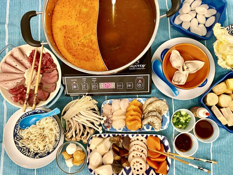 Fat Choi Hot Pot spread including broths and ingredients for cooking