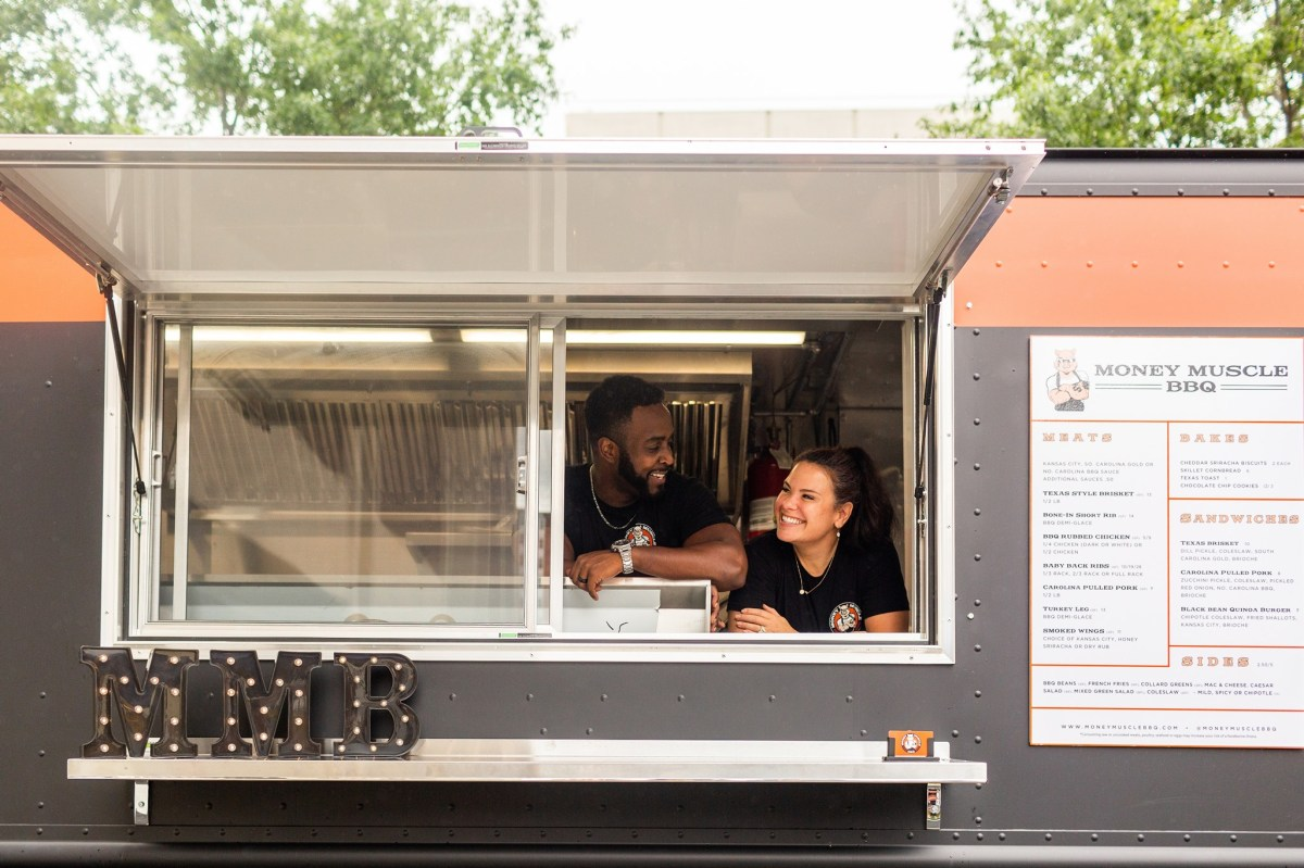 Money Muscle BBQ founders in their food truck