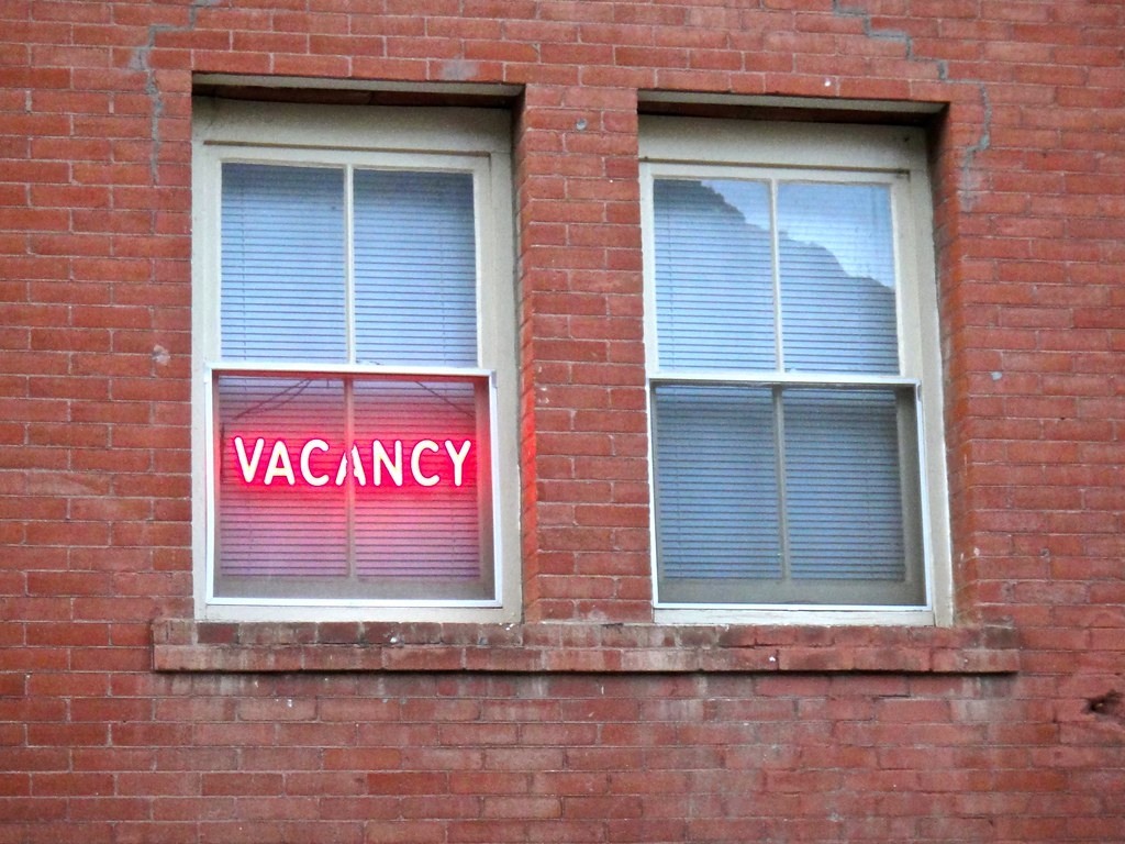 Vacancy sign in brick building