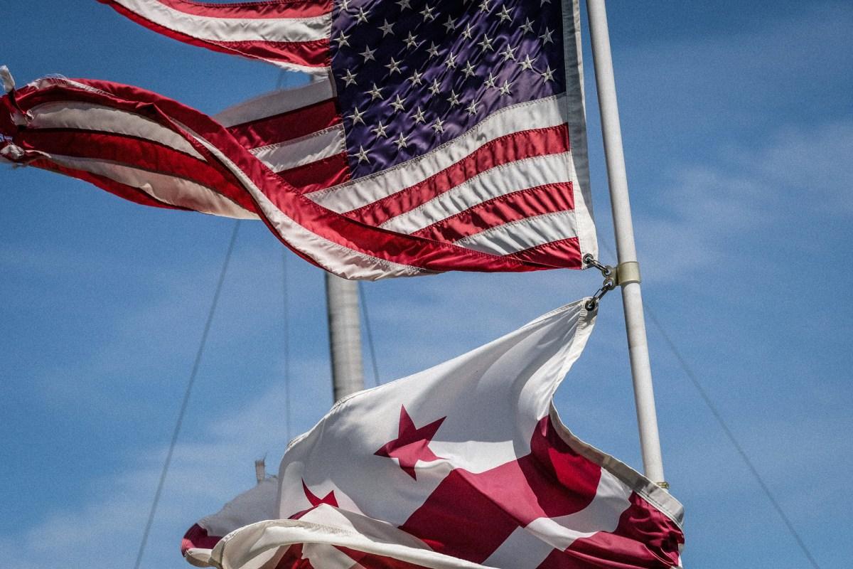 D.C. flag flying under USA flag