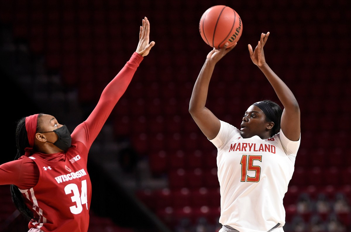 Maryland women's basketball team guard Ashley Owusu shoots over Wisconsin's Imani Lewis