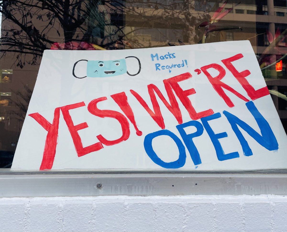 Yes We're Open sign at a restaurant