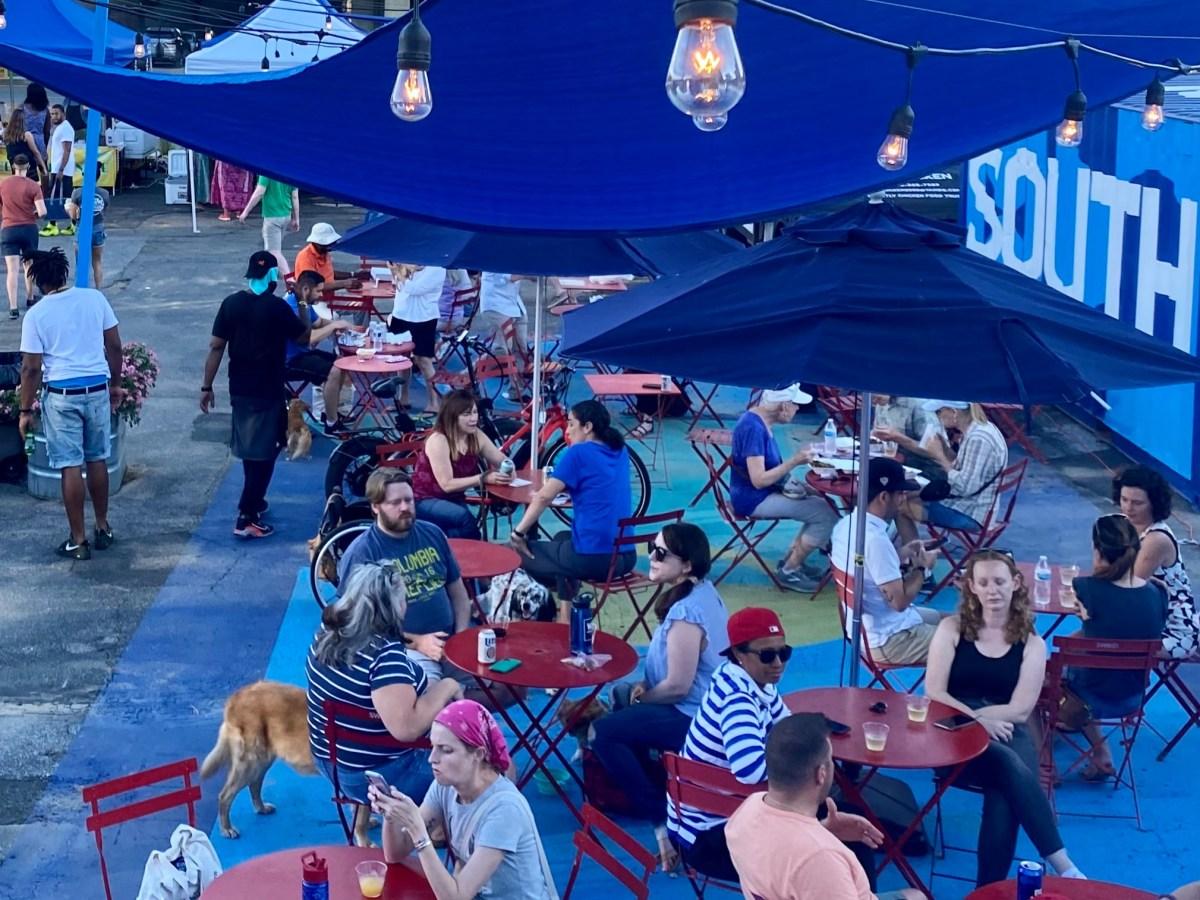 Vendors and visitors enjoying MarketSW