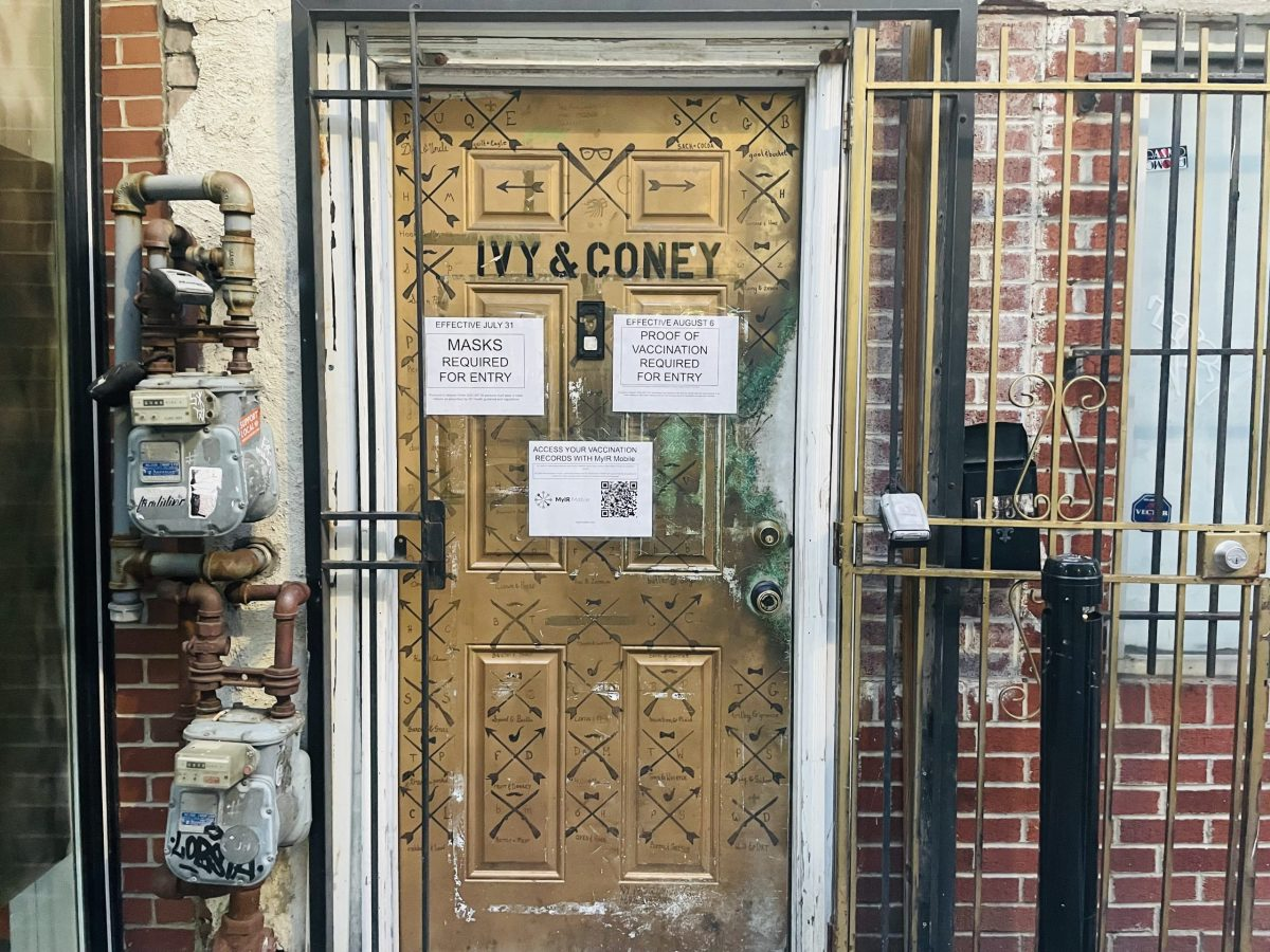 Door of Ivy and Coney displaying vaccination requirements