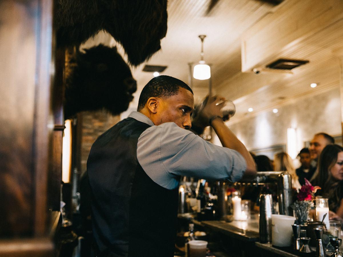 Bartender shaking a drink at Beuchert's Saloon