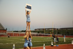 JV cheer on the sidelines early on a Friday night.