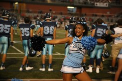 Junior Brianna Johnson cheers as the Jags take on Brandeis.