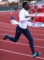 Junior Victoria Olankuwan hold the baton as she sprints her leg of the relay. Photo by Victoria Boesen.