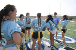 Junior girls prepare for the game.
