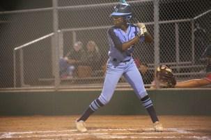 Senior Mikayla Briggs waits at bat to hit a home run. Photo by Danielle Bellow.