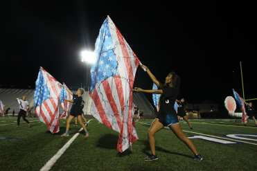 The ending flag feature also includes the dancer, not just the colorguard. Photo by Adelin Blackmon.