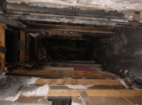 The fire started by an electric spark that light up the insulation within the attic.