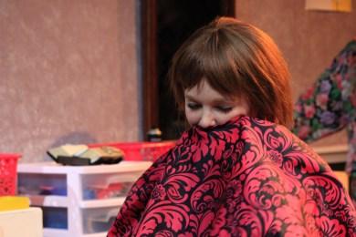 Macy Nicholson tucks her head in because she loves her new haircut.