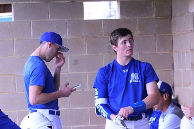 Junior Jace Jung standing in the dugout at the Clemens scrimmage.