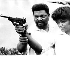 Mabel & Robert Williams (Author of Negroes with Guns) aiming the gun with precision, just as our revolutionary theory should be aimed