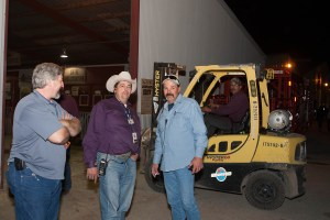 (Image) Edwin Martin, center, a production supervisor at CPS Energy, oversees more than 1,200 volunteers each year at the Stock Show & Rodeo.