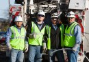 (Image) Line crew standing behind a utility truck