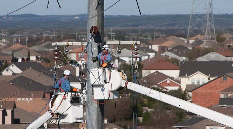(Image) Line crew working high up on a main electricity pole