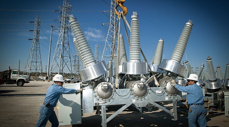 (Image) CPS Energy employees upgrading a substation; similar upgrades will require an increase in rates.