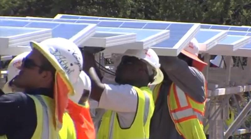 (Image) Crews installing dual axis solar panels at Alamo I, a 41 MW solar farm in San Antonio.