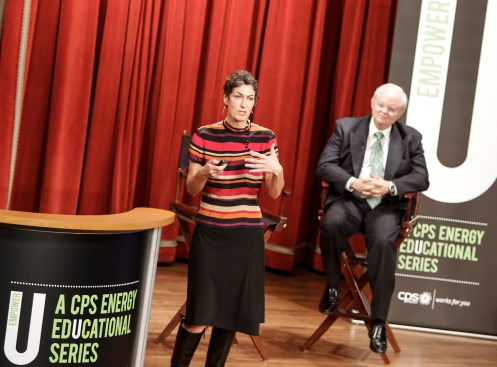 (Image) Big Play Inc. founder Nancy Giordano talks to CPS Energy employees while Vice President of Human Resources Les Real looks on.