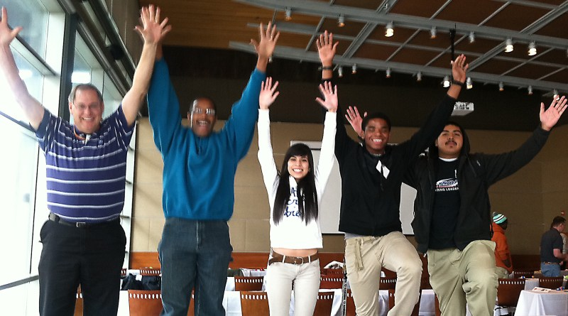 (Image) A positive attitude makes CPS Energy's Inspire U mentors and students jump for joy.