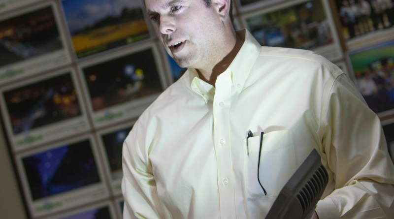 (Image) VP Tom Wright holds one of GreenStar's LED street lights.