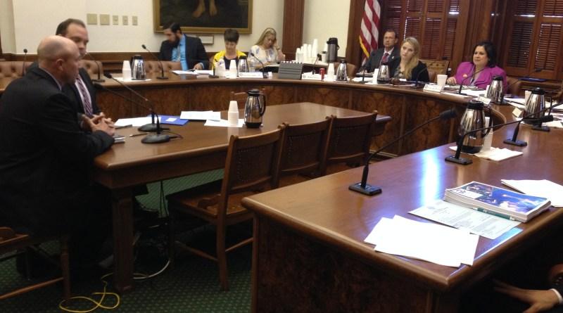 (Image) CPS Energy's Eric Cloudt, left, testifies to Senate Veteran Affairs committee.