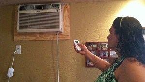 (Image) Customer Becky Torres tries her Cool Energy smartAC kit.