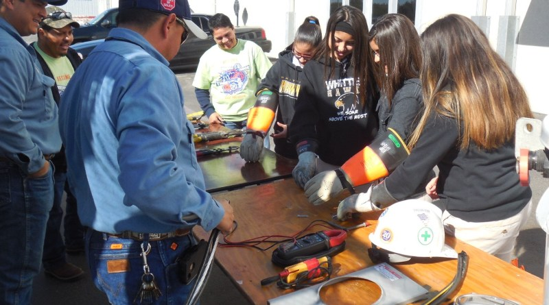 (Image) Middle school students try on the gloves CPS Energy linemen must wear.