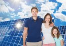 (Image) Family by solar panels