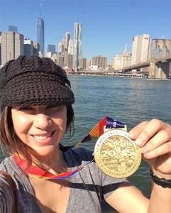 (Image) Carla celebrates finishing the New York City Marathon.