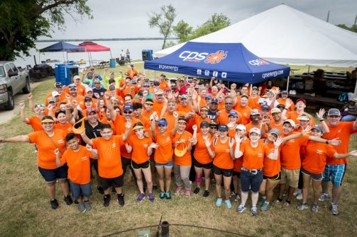(Image) Volunteers gather for a group shot at the start of last year's Kids Fish Day.