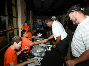 (Image) CPS Energy employees Johnny Garza and Kaycee Hickman help players check-in for the tournament. Nearly 30 CPS Energy employees and about 20 SAMMinistries volunteers provided valuable event support during the tournament.