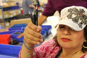 (Image) Alicia Cortinas, a general assembler like Raul, shows off some of her handy work at San Antonio Lighthouse. The Skilcraft pens are considered one of the best in the business. Despite having barely any vision, she's enjoyed a rewarding career at San Antonio Lighthouse.