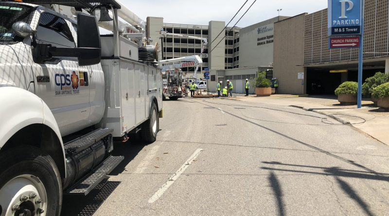 CPS Energy crew working alongside the street
