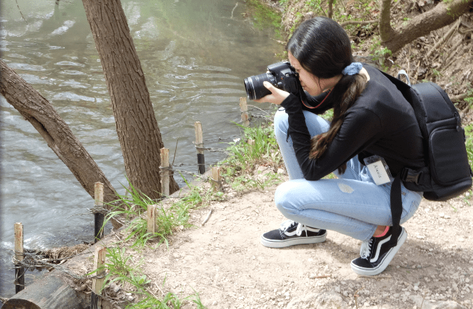 A PYW Photography student takes a photo at Bulverde Oaks Nature Preserve