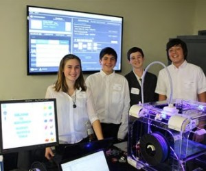 An image of McPherson Magnet students displaying a technology project