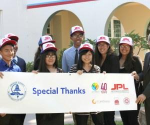 Santa Ana students wearing JPL hats