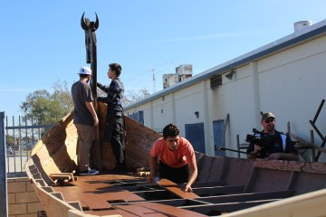 Students building a Viking shop at Marina High