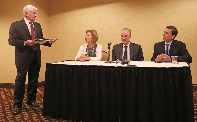 Safe Schools Conference organizer Dave Long (left) leads panel discussion with OC Sheriff Sandra Hutchens, state Superintendent Tom Torlakson and OC Superintendent Dr. Al Mijares