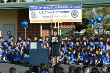 Students from Cook Elementary gathered on the blacktop for a National Blue Ribbon ceremony