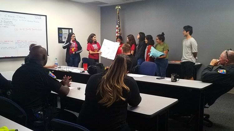 High school students making a presentation