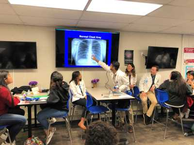 Medical students point to an X-ray image