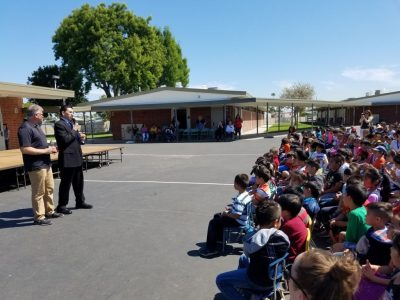 Carlos Primiani is named an Orange County Teacher of the Year during an assembly at Leo Carrillo Elementary School